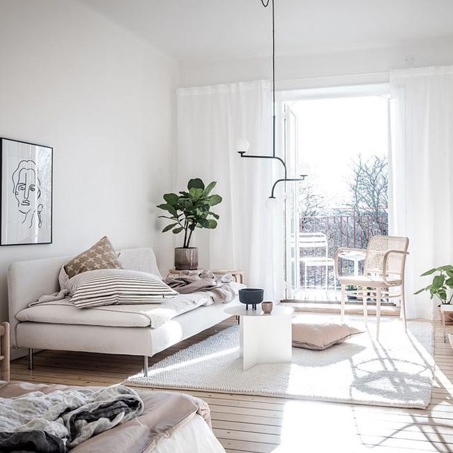deco salon scandinave beige fauteuil cannage
